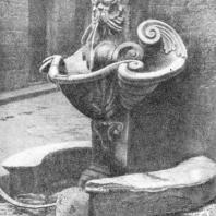 Средневековый питьевой фонтан на углу улицы. Флоренция. Италия